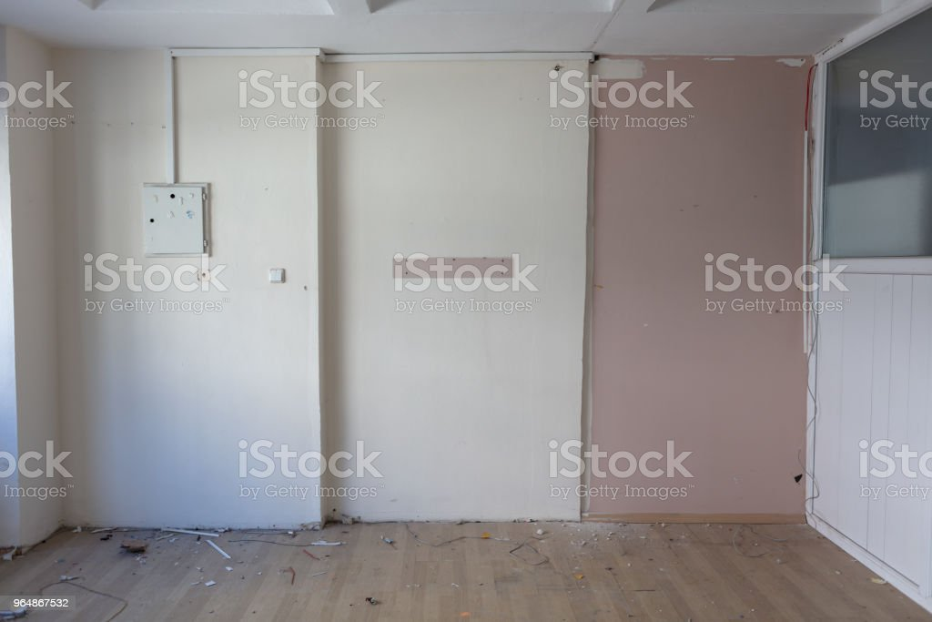 inside of an abandoned grungy room with concrete wall royalty-free stock photo