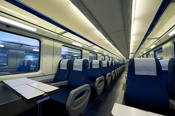innerhalb von einem leeren passenger train car - kopfstütze stock-fotos und bilder