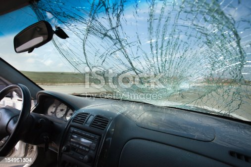 istock Inside of car with the broken windshield. Road accident 154961304