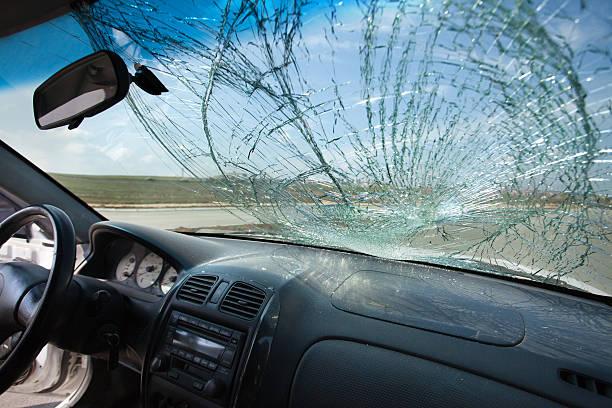 inside of car with the broken windshield. road accident - voorruit stockfoto's en -beelden