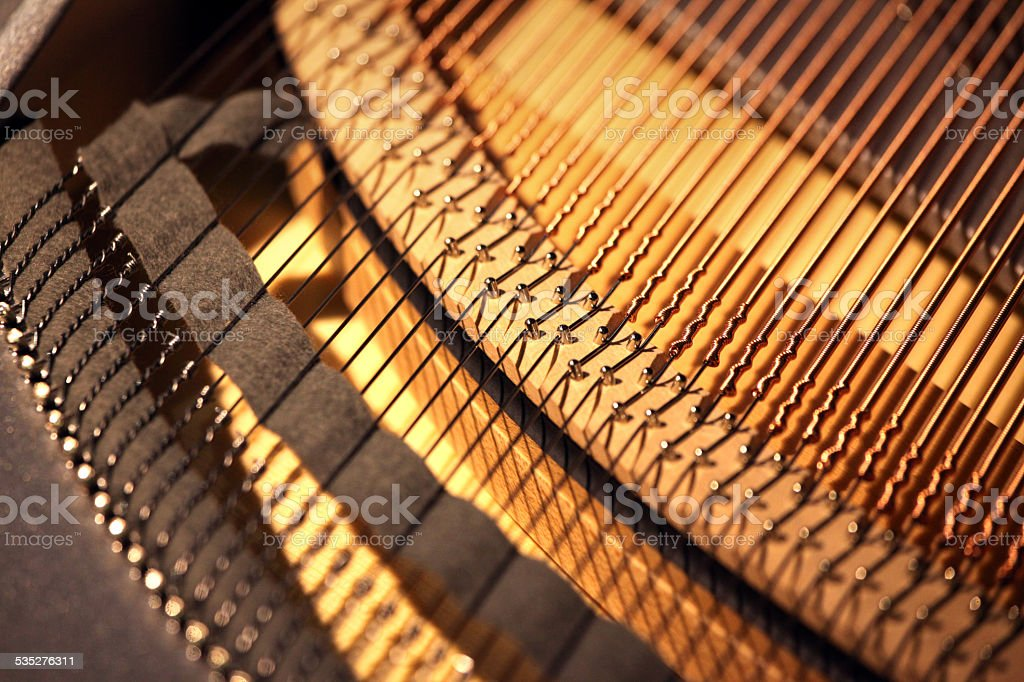Inside of grand piano, showing gears and strings stock photo