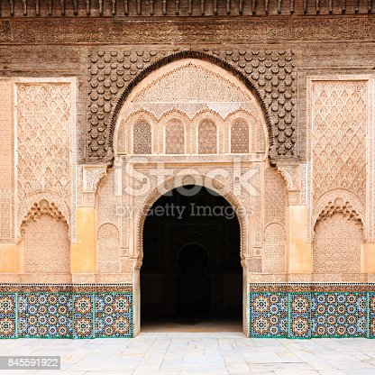 Inside of The Ali Ben Youssef Madrassa. The Ben Youssef Madrassa was an Islamic college in Marrakech, Morocco, North Africa. It is the largest Medrasa in all of Morocco.