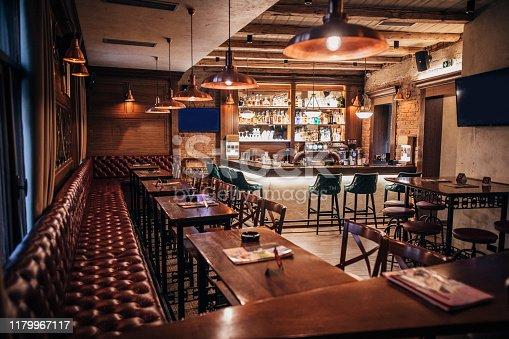 Inside of modern empty pub, no people.