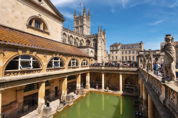 inside of Roman Baths which is a site of historical interest in the city of Bath. The landmark is a well-preserved Roman site for public bathing Bath, England - May 13, 2019 : inside of Roman Baths which is a site of historical interest in the city of Bath. The landmark is a well-preserved Roman site for public bathing . bath england stock pictures, royalty-free photos & images