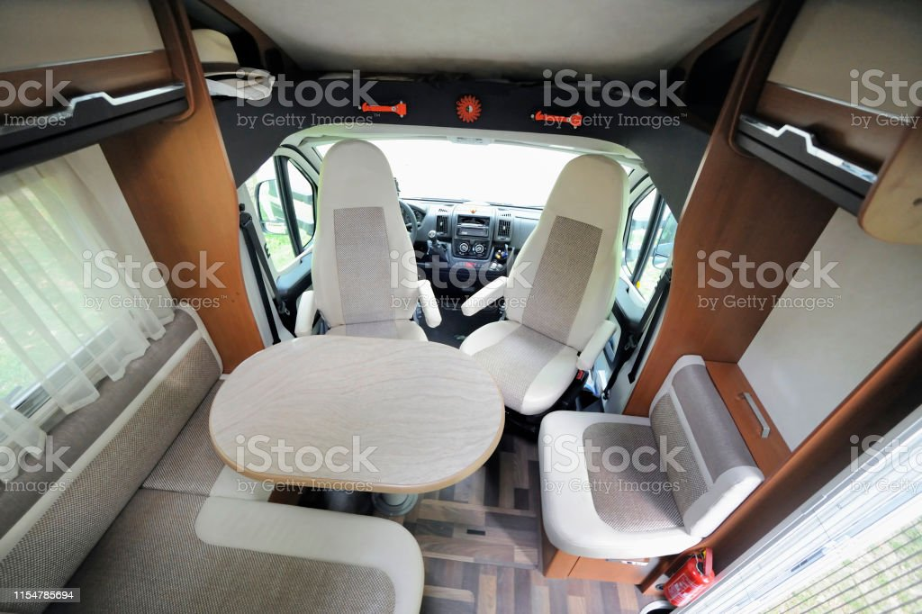 Inside of RV Camper Cabin Interior With Rotating Seats in Recreation Vehicle Bus Stock Photo