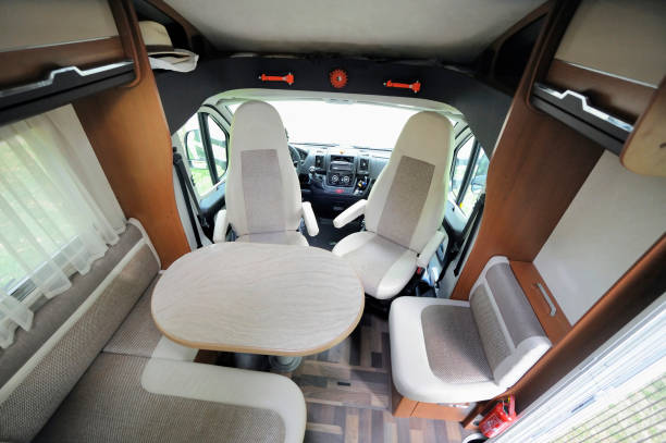 Inside of RV Camper Cabin Interior With Rotating Seats in Recreation Vehicle rv interior stock pictures, royalty-free photos & images