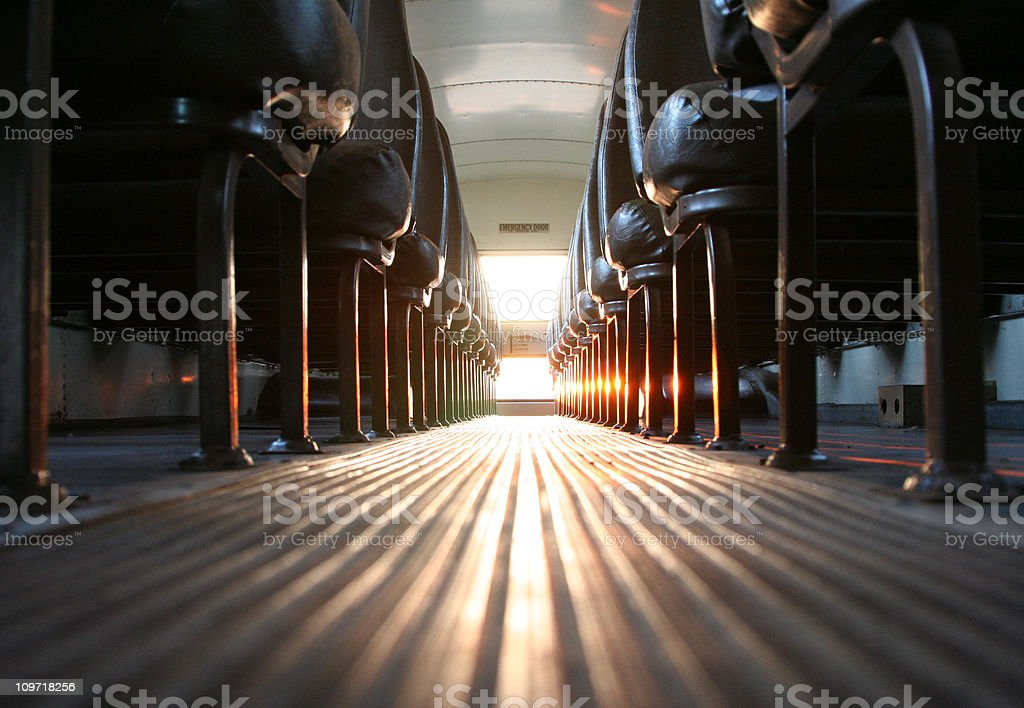 Inside of School Bus with Sun Shining In stock photo