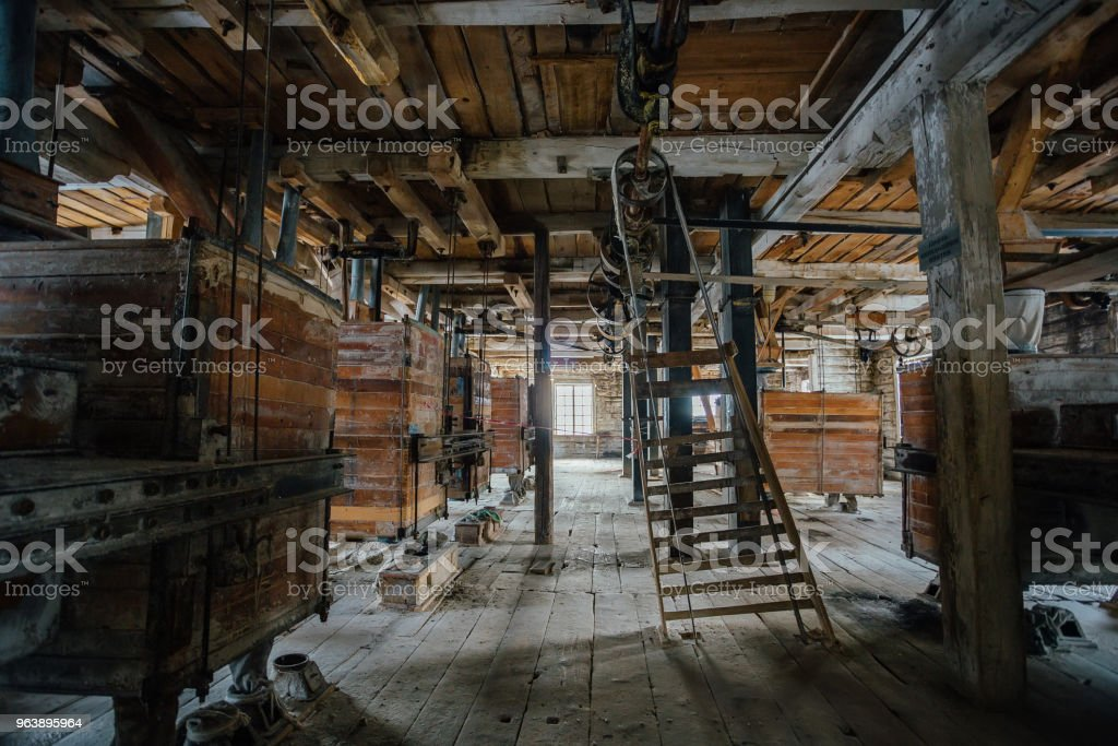 Inside old abandoned wooden mill with old equipment - Royalty-free Abandoned Stock Photo