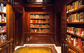 Brussels, Belgium: Inside old room with books on bookshelves with paper volumes and antique wooden furniture of the Royal Library on April 4, 2018. More than 1,200,000 people lives in Brussels