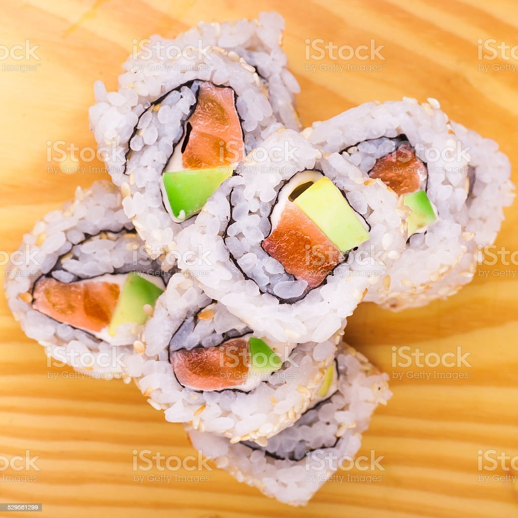 inside out sushi roll with salmon and avocado stock photo