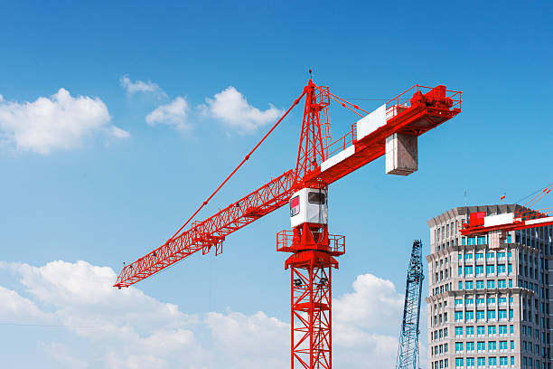 Inside place for tall buildings under construction and cranes. stock photo