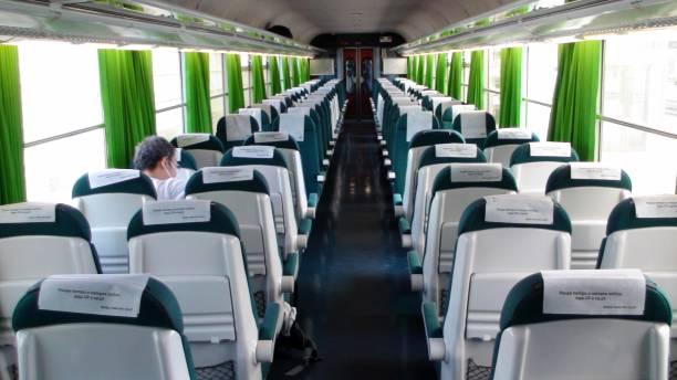 inside portugal public transportation train, people view - resultados lisboa imagens e fotografias de stock