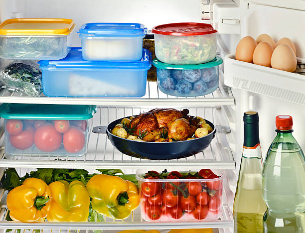 Inside Refrigerator Open Refrigerator with Assortment of Food and Beverages fridge stock pictures, royalty-free photos & images