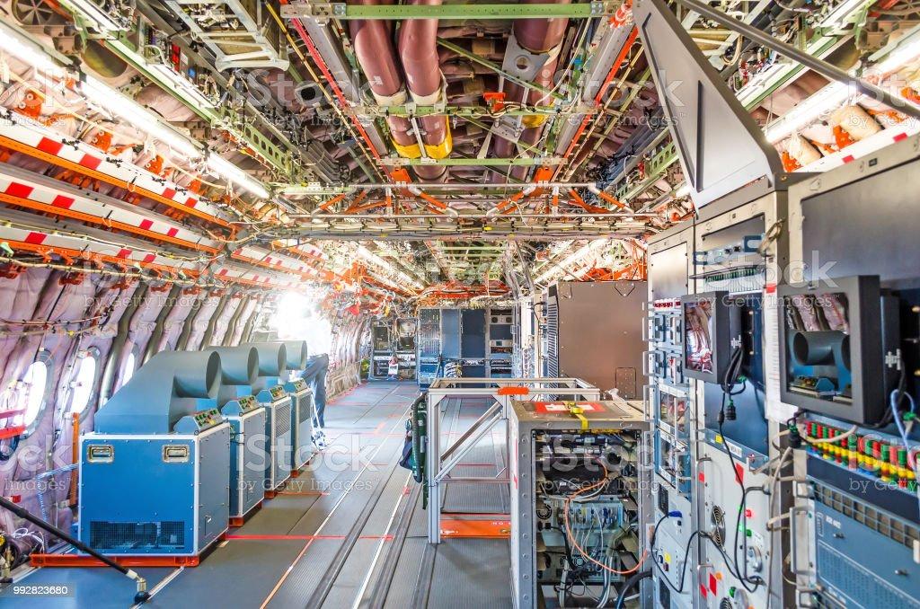 Inside the aircraft under test the equipment is salon equipment mechanisms. stock photo