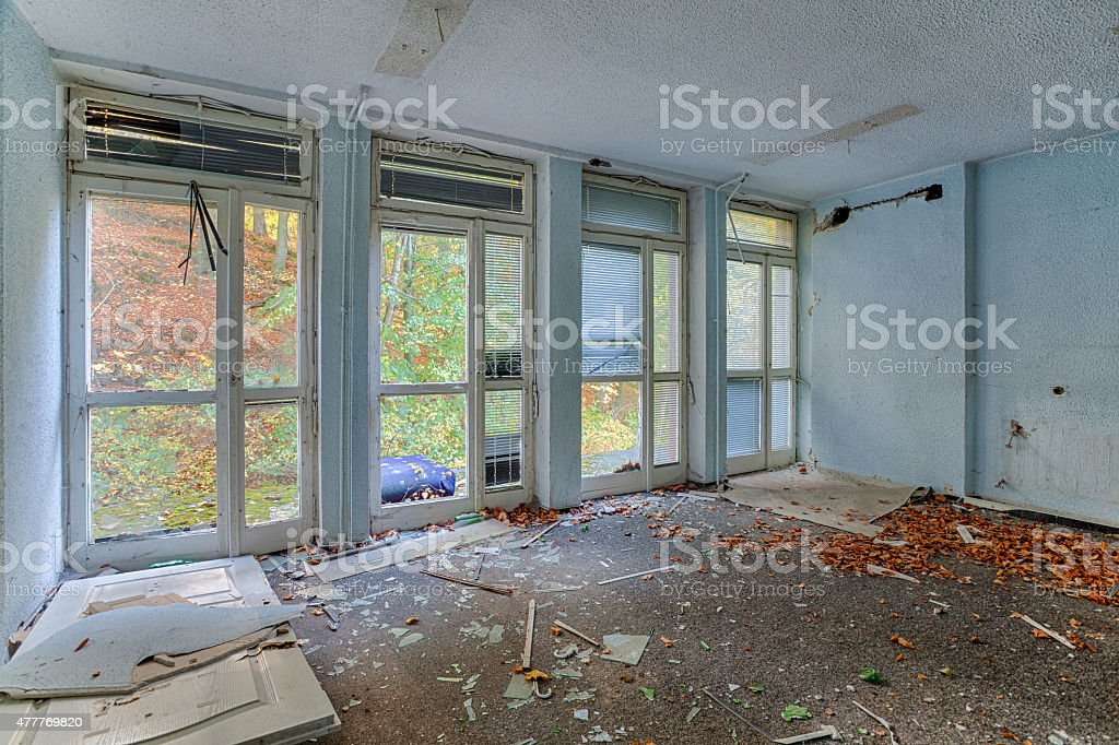 Inside the destroyed house on the edge of the forest stock photo
