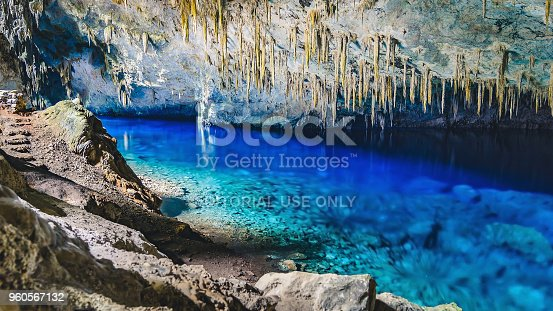 istock Inside the grotto of Lago Azul, a grotto with a lake with transparente vibrant blue water 960567132
