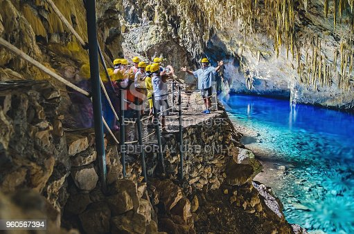 istock Inside the grotto of Lagoa Azul, a group of tourists 960567394