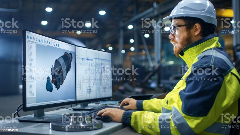 Inside the Heavy Industry Factory Industrial Engineer Works on the Personal Computer Designing Turbine/ Engine in 3D, Using CAD Program. stock photo