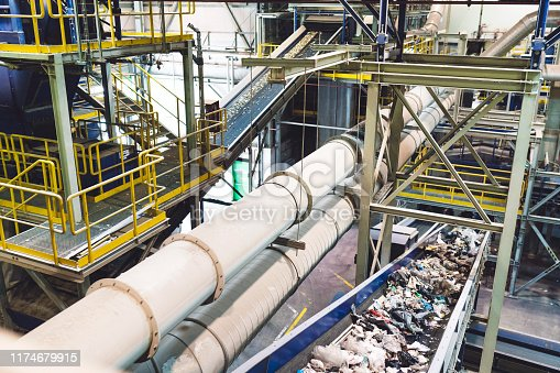 Conveyor belts full of waste inside the recycling center facility