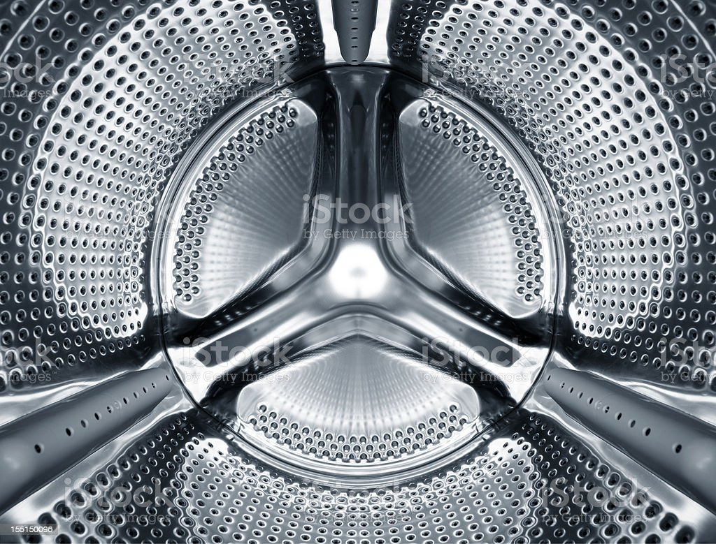 Inside the steel drum of a washing machine stock photo