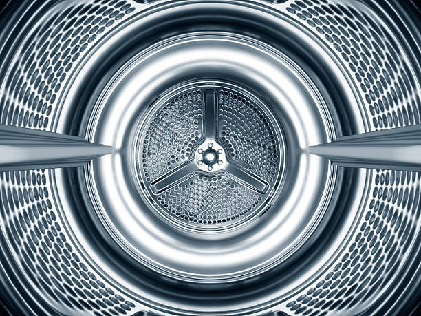 Inside the steel drum of a washing machine Inside the steel drum of a washing machine centrifuge stock pictures, royalty-free photos & images
