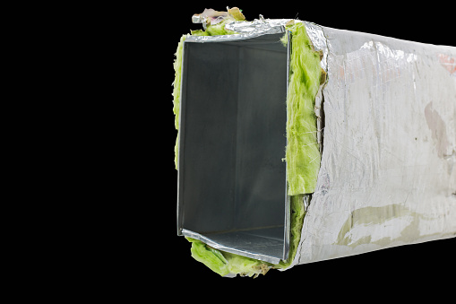 Tube ventilation ducts made of galvanized sheet and fiber glass on black background .