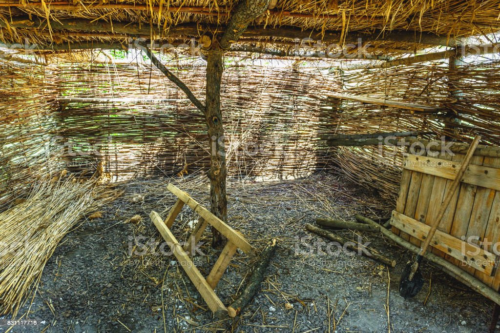 Inside the village straw barn, storage for tools stock photo