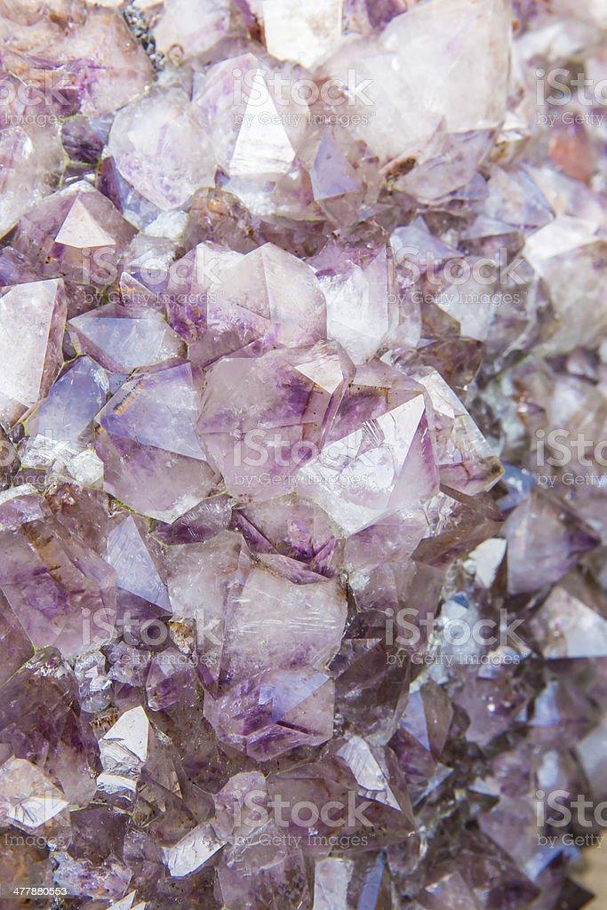 Inside uncut amethyst geode background stock photo