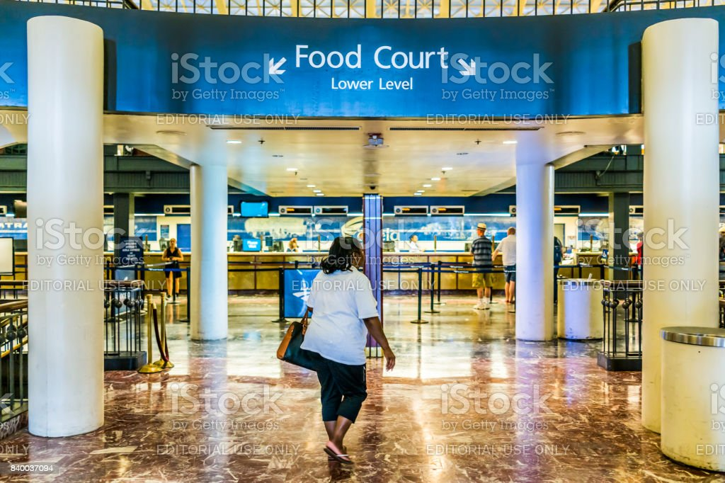 Inside Union Station in capital city with food court sign and people walking by ticket booths stock photo