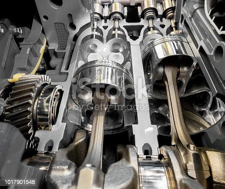 istock Inside view of 4 stroke engine cylinders, pistons and valves 1017901548