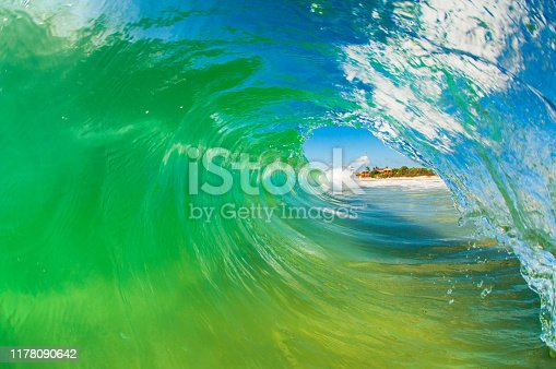 istock Inside view of a barreling wave breaking on the shore at Campeche beach in Florianópolis Brazil 1178090642