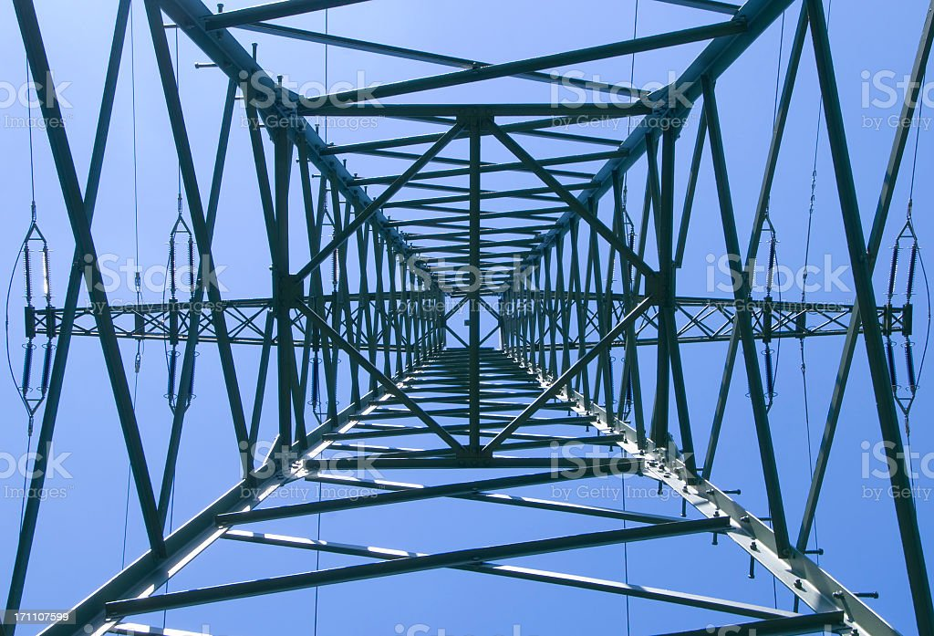 Inside view of a power pylon with blue sky stock photo