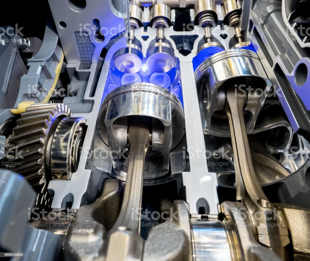 Inside view of engine cylinders, pistons and valves stock photo