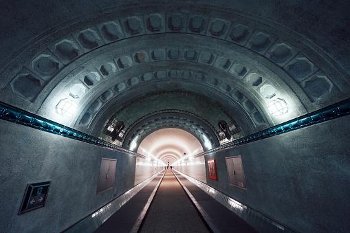 inside view of illuminated old Elbtunnel in Hamburg