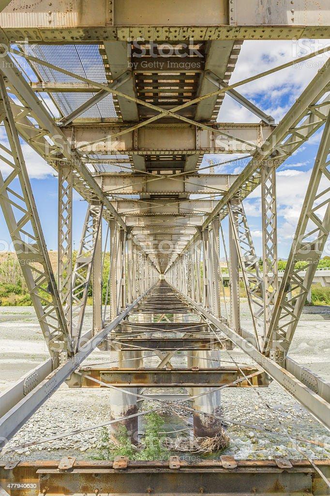 Inside view of old steel railway bridge stock photo