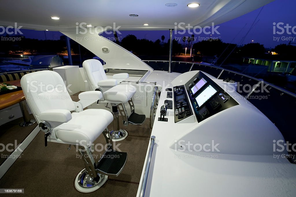 Inside view of yacht cabin with white panel and chairs stock photo