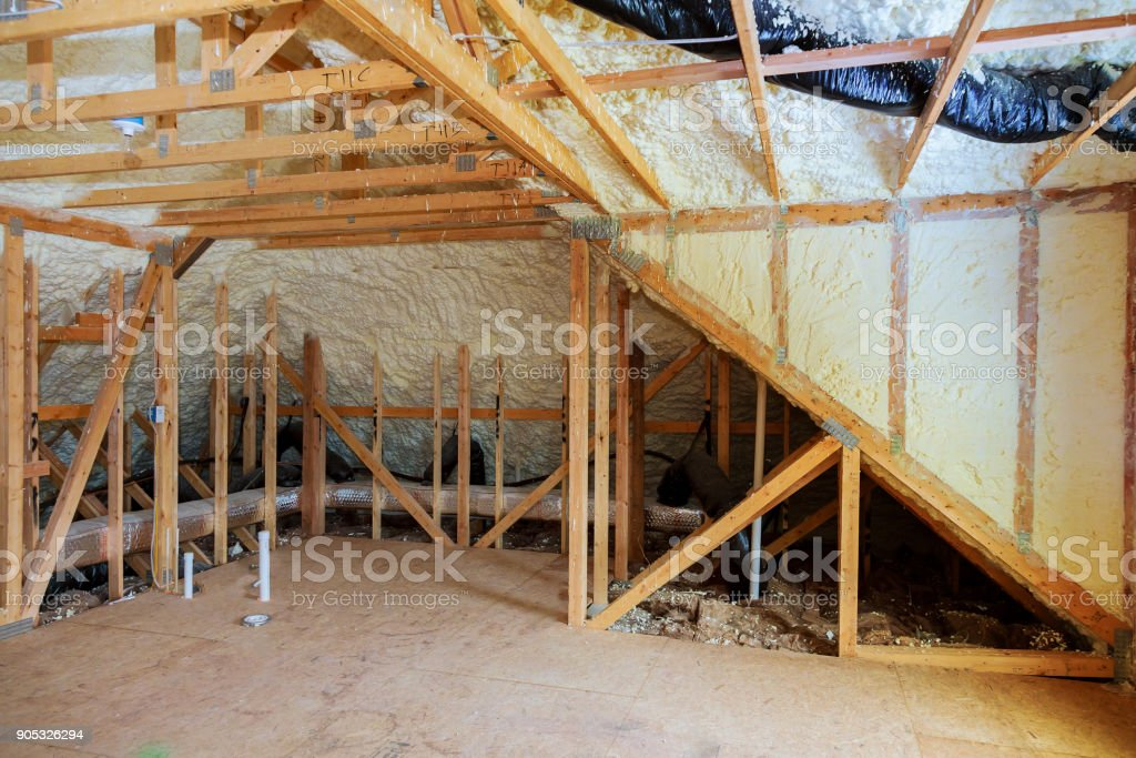 Inside wall heat isolation with mineral wool wooden house, building under construction stock photo