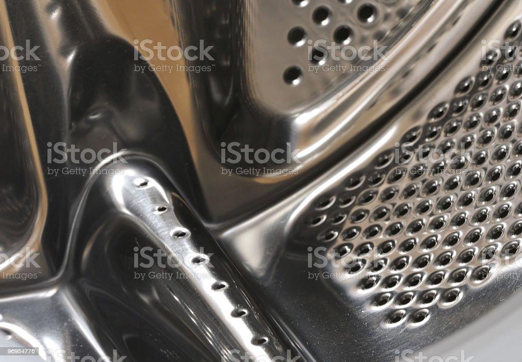 Inside washing machine, drum closeup royalty-free stock photo