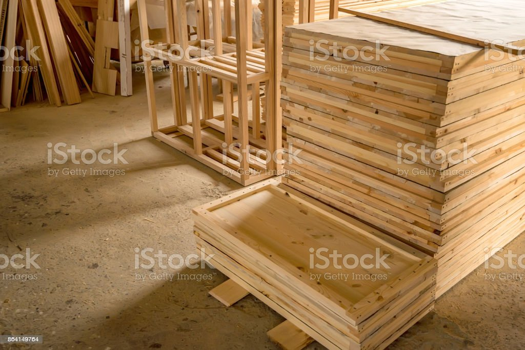 Inside woodworking workshop with lumber in front royalty-free stock photo