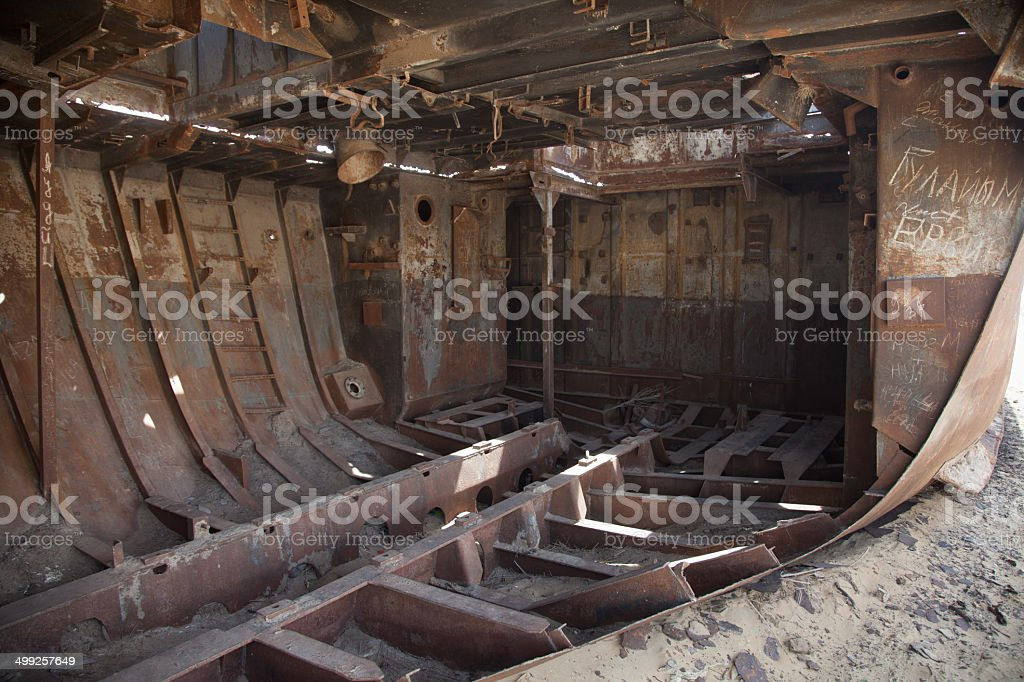 Insides of abandoned ship in Aral Desert, Moynaq, Karakalpakstan, Uzbekistan royalty-free stock photo