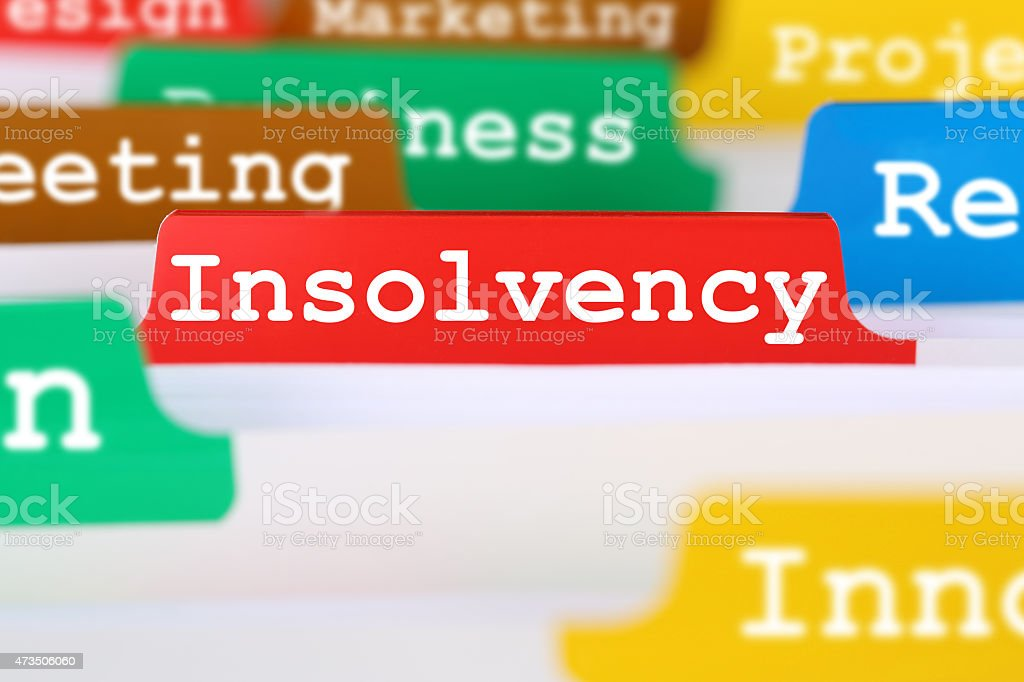 Insolvency, bankruptcy or liquidation business concept register in documents stock photo