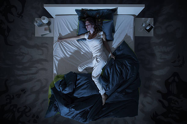 insomnia and nightmare in bed at night stock photo