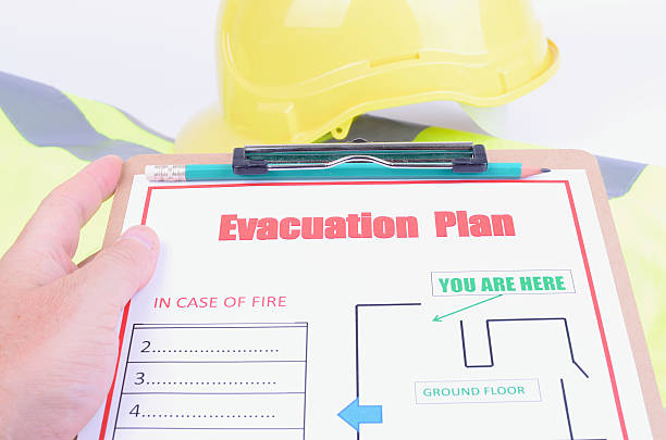 Inspecting an Evacuation Plan stock photo