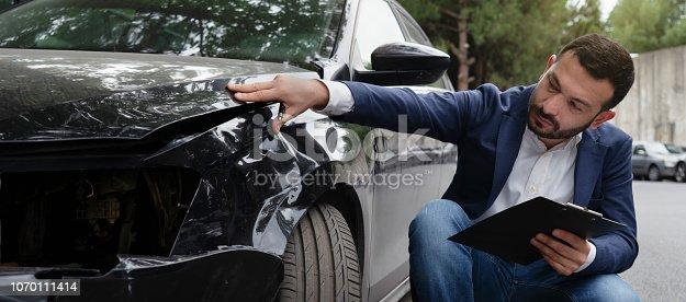 istock Inspecting Car Damage After A Crash 1070111414