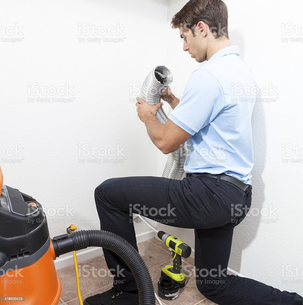 Inspecting Dryer Duct stock photo