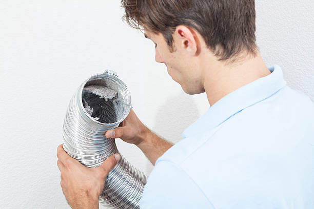 Inspecting Dryer Vent tube stock photo
