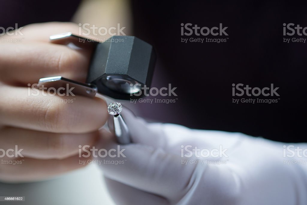 Inspecting for flaws stock photo
