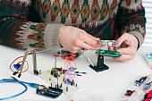 istock Inspecting new electronic component free space 646165470