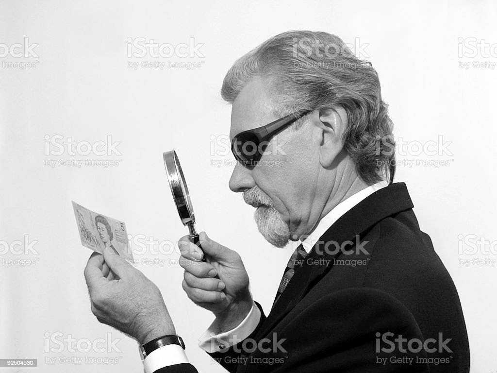 Inspecting the fiver royalty-free stock photo