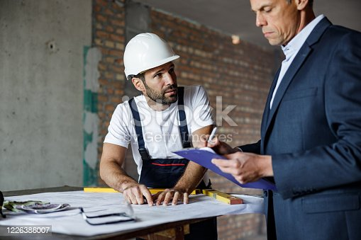 891274328 istock photo Inspection at construction site! 1226386007
